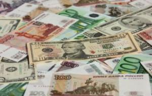 Официальный курс доллара опустился ниже 65 рублей