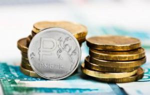 Доллар упал до отметки 57,45 рубля, обновив минимум 2015 года